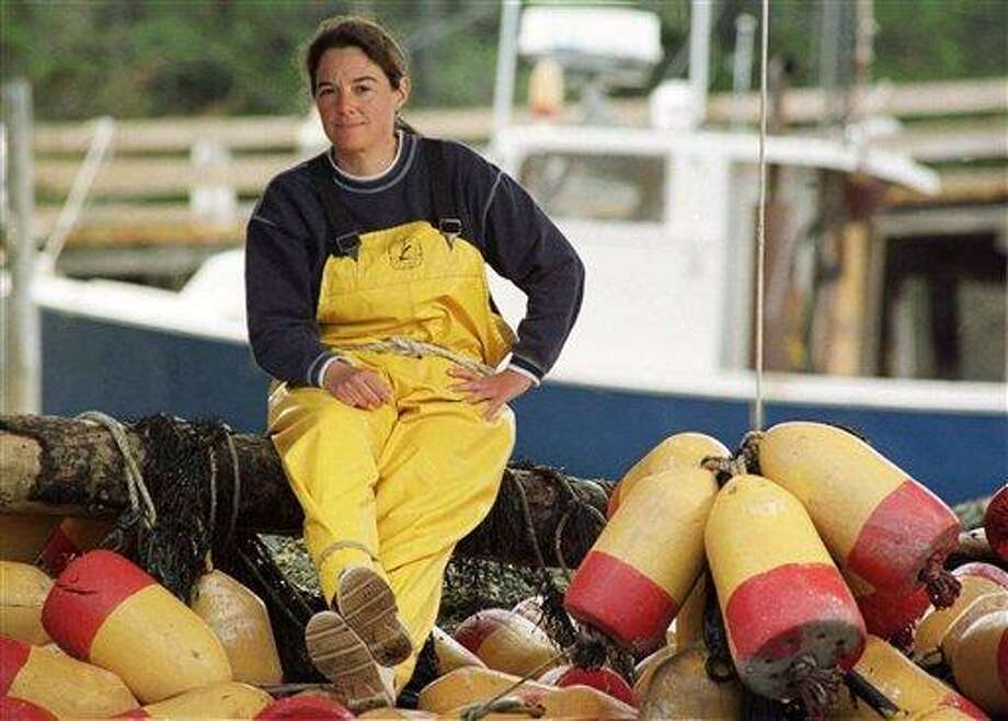 """FILE - In this May 1999 file photo, swordfish boat captain Linda Greenlaw poses on Isle Au Haut, Maine. To improve sales, seafood sellers are attaching the name of celebrity fishermen, such as Linda Greenlaw, to help move their product.  Greenlaw is the Maine boat skipper featured on the Discovery Channel reality show, """"Swords: Life on the Line"""" (AP Photo/Robert F. Bukaty, File) Photo: AP / AP"""