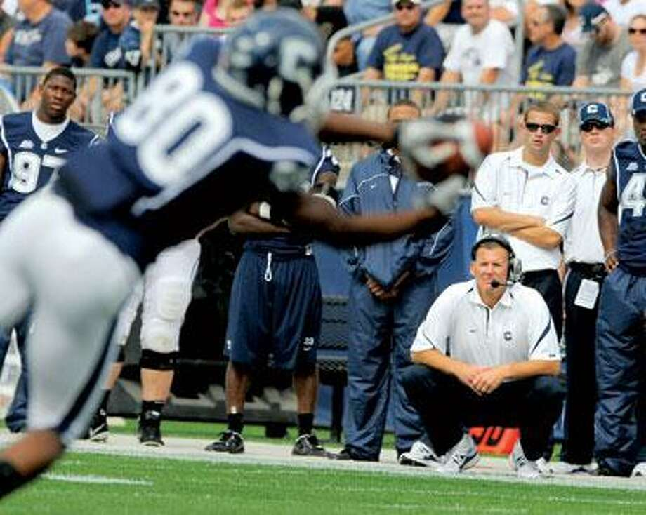 Connecticut head coach Randy Edsall, lower right, watches wide receiver Michael Smith during the first half of Connecticut's 45-21 victory in their NCAA football game in East Hartford, Conn., on Saturday, Sept. 25, 2010. (AP Photo/Fred Beckham)