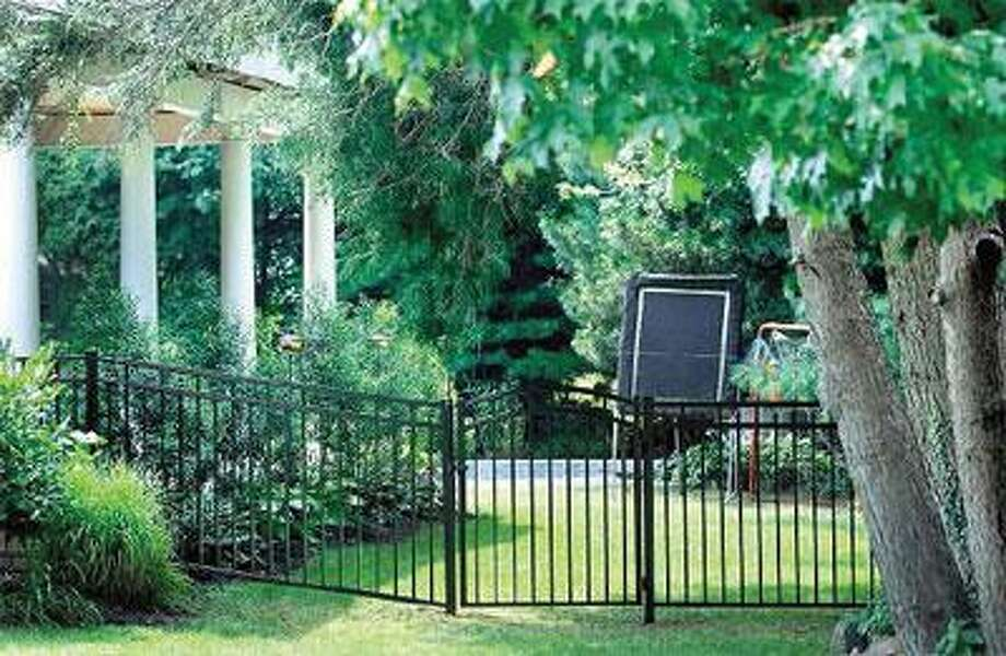A new fence encloses the backyard of 42 McKinley Ave. where the pool is located. (Arnold Gold/Register)