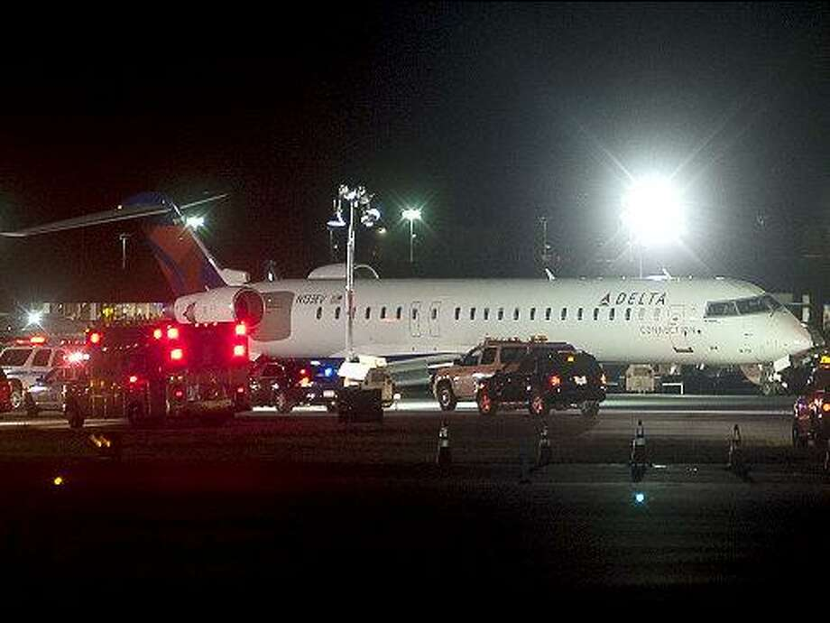 This Delta airline is shown on the runway after being evacuated late Saturday night at JFK airport. Police report the plane landed and skidded off the runway causing a flat tire.   Original Filename: Taggart-1.jpg