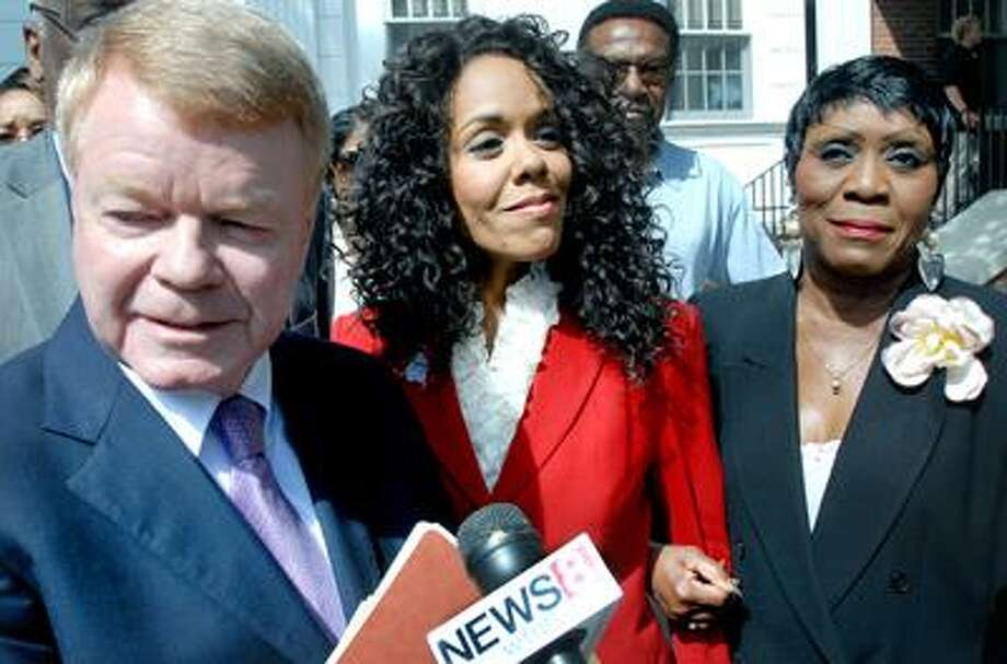 Attorney Hugh Keefe (left) makes a statement to the press concerning former WTNH-TV host Desiree Fontaine (center) after a court appearance on shoplifting charges at Milford Superior Court on 7/27/2010.  At right is Carroll Brown, president of the West Haven Black Coalition.Photo by Arnold Gold   AG0379D