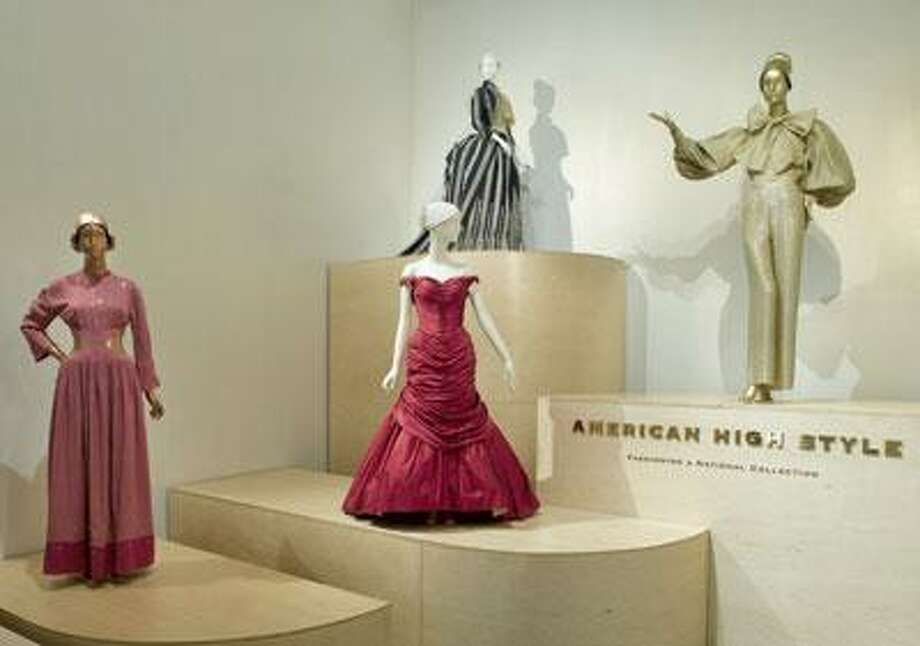 "The 85-piece wardrobe from ""American High Style: Fashioning a National Collection"" at the Brooklyn Museum includes an evening dress by American designer Bonnie Cashin from 1945, left; a red silk evening dress by American designer Charles James, who is considered America's first couturier; a ""walking dress"" from 1885 by Charles Frederick Worth; and lounging pajamas created by Norman Norell in 1970-71. (Photos courtesy of the Brooklyn Museum)"