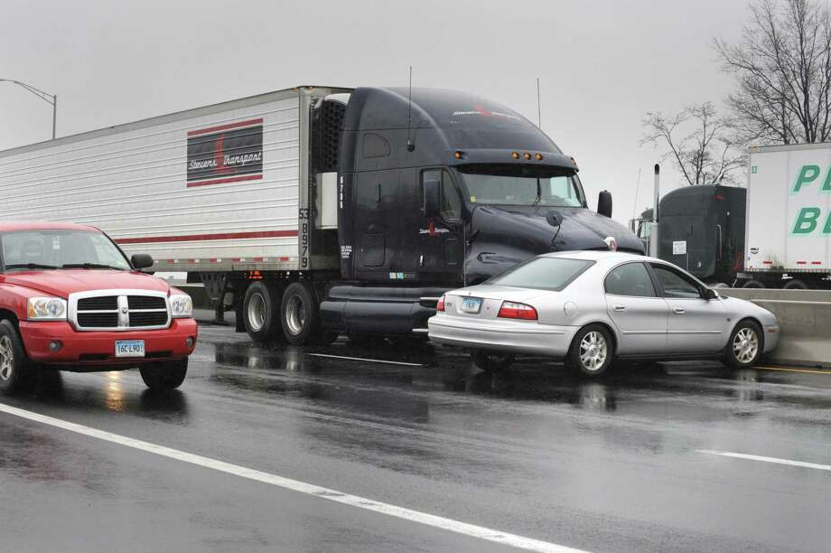 An accident between an eighteen-wheeler and passenger vechicle at the top of the Exit 46 on-ramp on Interstate 95 tied up traffic around noon Tuesday. VM Williams