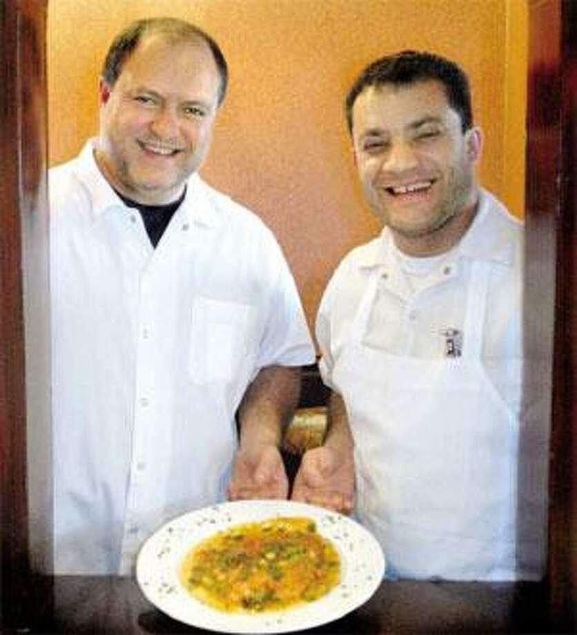 LoMonaco's chef and owner Vincenzo LoMonaco, left, and chef Alante Esposito with the Branford restaurant's Tilapia Casa Mia. (Melanie Stengel/Register)