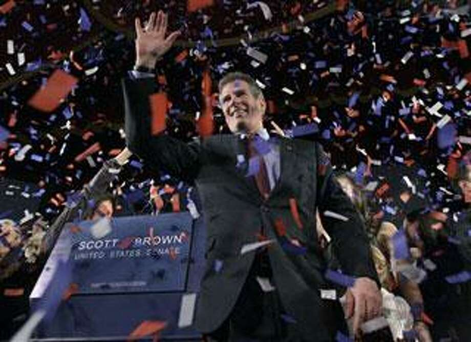 Massachusetts State Sen. Scott Brown, R-Wrentham, celebrates in Boston, Tuesday, Jan. 19, 2010, after winning a special election held to fill the U.S. Senate seat left vacant by the death of Sen. Edward Kennedy. Brown defeated Massachusetts Attorney General Martha Coakley, a Democrat, and Joseph L. Kennedy, a Libertarian running as an independent and not related to the late Sen. Kennedy. (AP Photo/Elise Amendola)