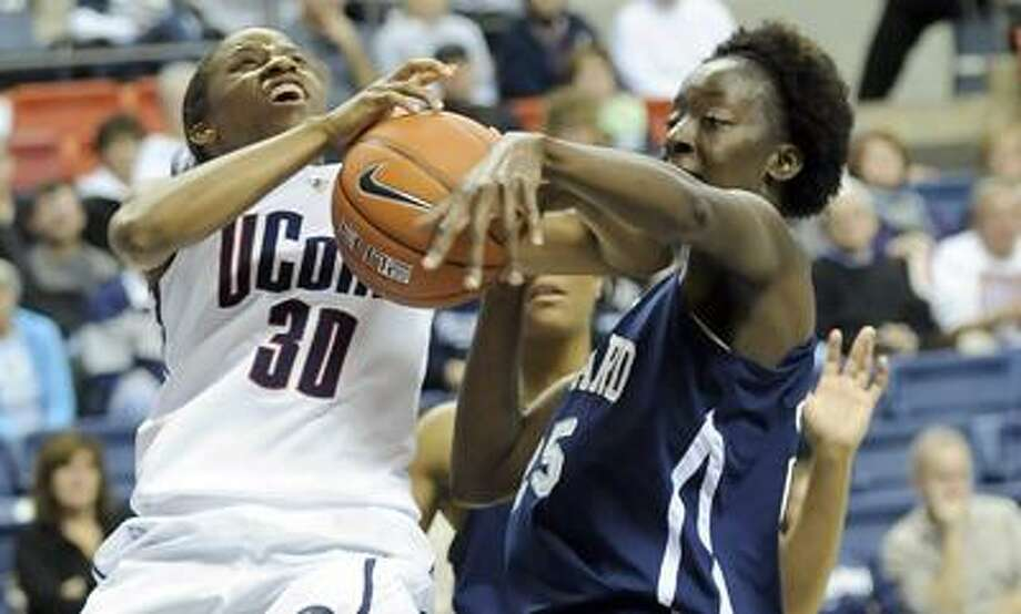 UConn's Lorin Dixon, left, and Howard's Julee' O'Neal battle for a rebound during the second half the No. 1 Huskies' 86-25 win Friday in Storrs. (AP Photo/Bob Child) Photo: AP / FRE 170410 AP