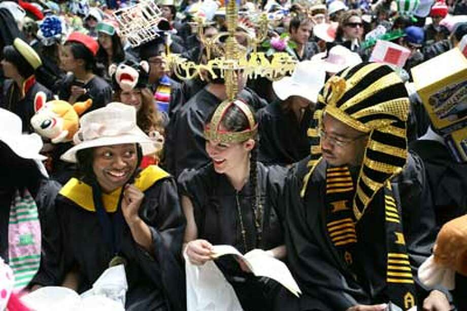 From left, Rolake Alabi of Hawthorn, N.Y., Deva Content of Los Angeles and Jaison Oliver of Detroit, all from Yale's Stiles College, enjoy the Class Day festivities. (Peter Casolino/Register)
