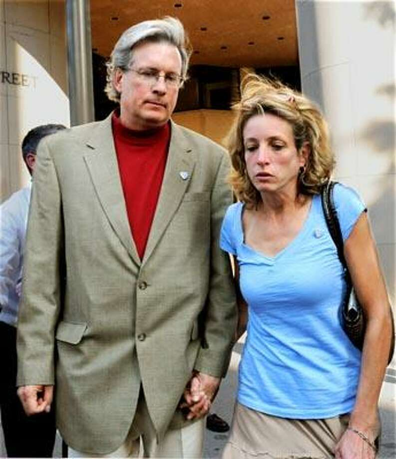 (ms092310)-Dr. William Petit Jr. and his sister Johanna Chapman leave Superior Court in New Haven.     Melanie Stengel/Register