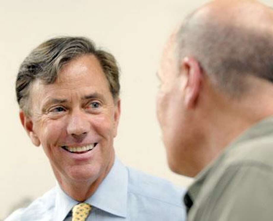 Democratic gubernatorial hopeful Ned Lamont talks with Jerry Kilgore, vice-president of Data Signal Corp. in Milford, during a campaing stop last week. (Mara Lavitt/Register)