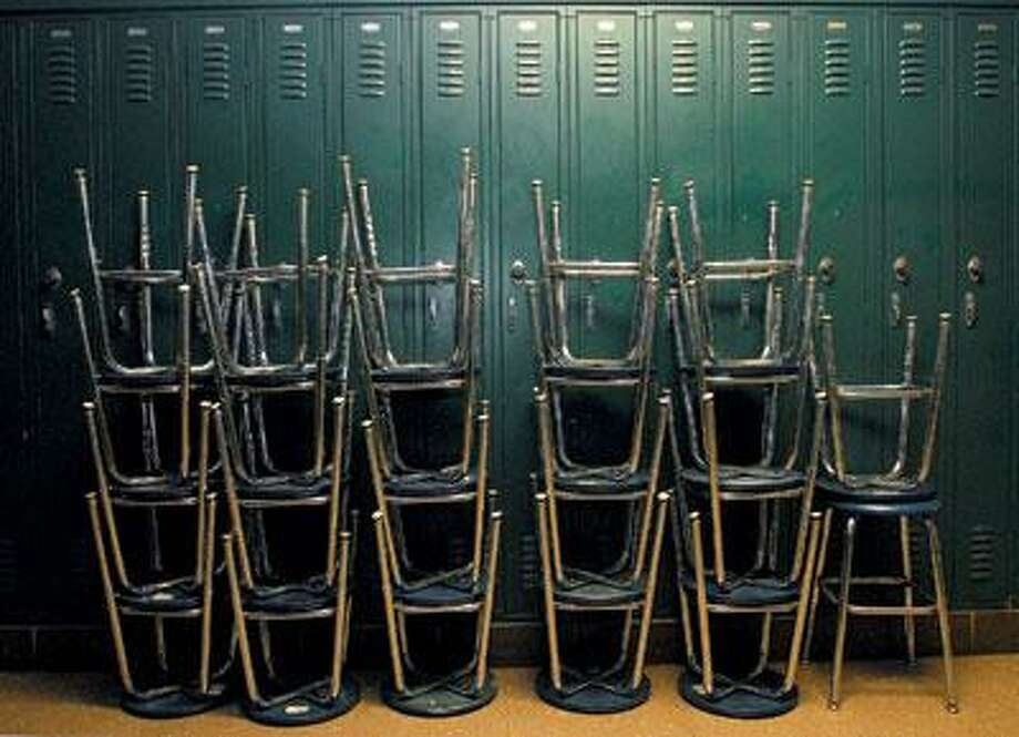 Stacks of stools wait to be placed in a science lab. (Brad Horrigan/Register)