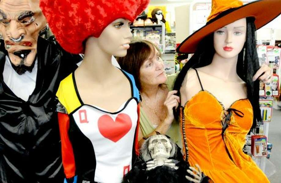 Photography by Peter Hvizdak            ph2167              #4204Guilford, Connecticut - September 23, 2010: Eileen Petrillo, owner of Characters and Costumes costume shop in Guilford, with some of her costume offerings for Halloween.