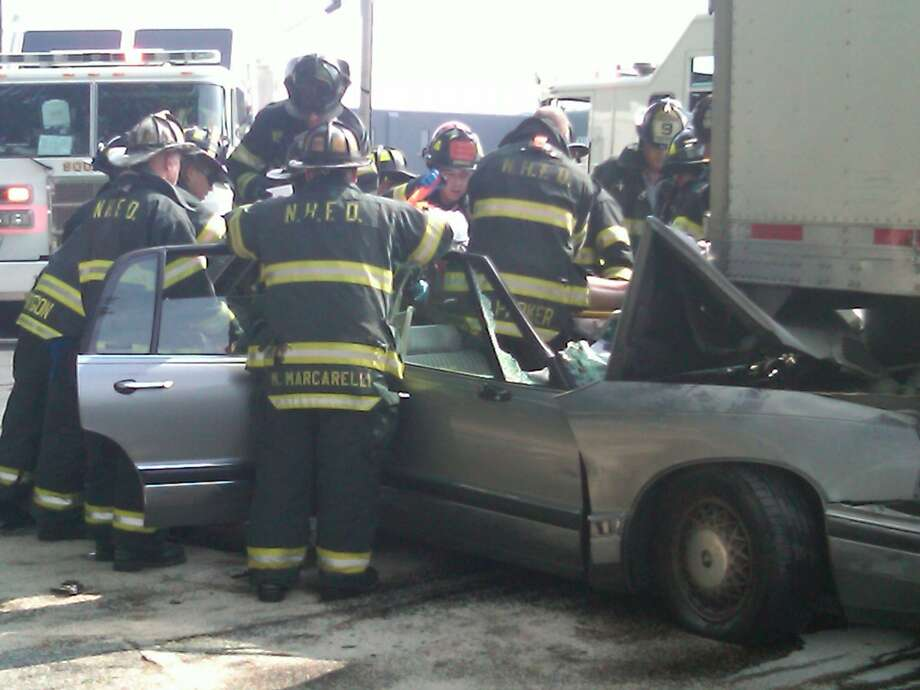 A man had to be extricated from his car after he rear ended this tractor trailer in New Haven. Photo by William Kaempffer