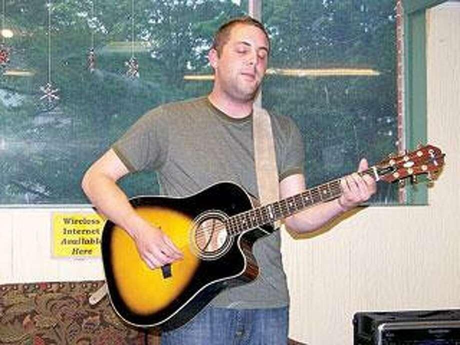 New Haven singer/songwriter Calvin DeCutlass reunites The Norton (DeCutlass, James Velvet, Johnny Java) once again for a show at Cafe Nine tonight. (Dave Kelsey)