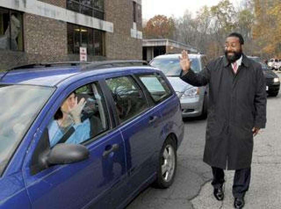 Rabbi Enan Francis, principal of Southern Connecticut Hebrew Academy in Orange, greets a parent picking up a student after school. (Peter Hvizdak/Register)