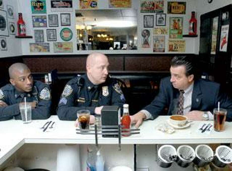 Madison Police Chief John Drumm, right, eats at the Madison Coffee Shop with Officer Sam Brown, left, and Sgt. Jonathan Pardo. (Arnold Gold/Register)