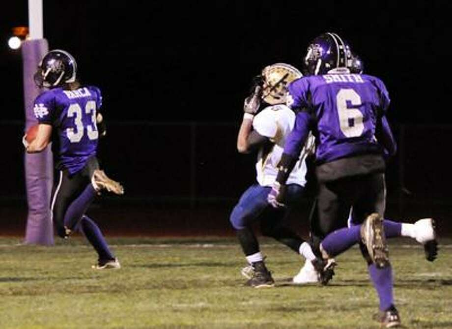 North Branford-  North Branford's Sal Varca recovers a fumble and scores a touchdown in 1st half action.     Melanie Stengel/Register11/24/10