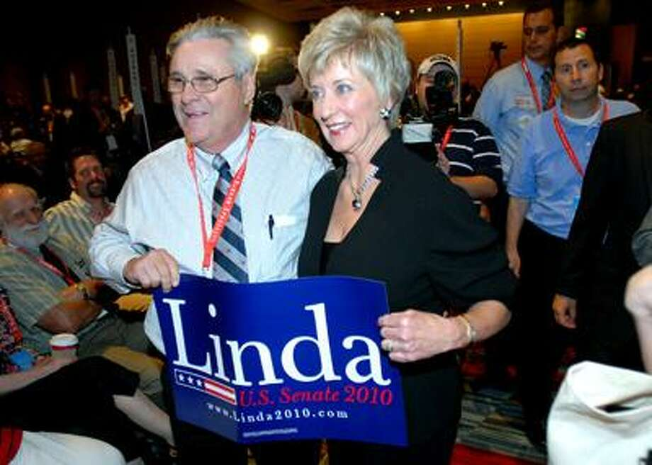 George Castle (left) of Plymouth gets his photograph taken with Linda McMahon (center) at the Republican State Convention in Hartford. (Arnold Gold /Register)