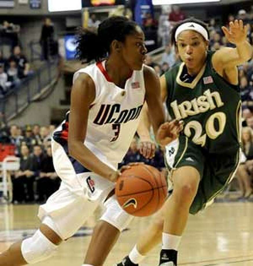 Connecticut's Tiffany Hayes drives past Notre Dame's Ashley Barlow in the first half of a women's NCAA college basketball game at Storrs, Conn., Saturday, Jan. 16, 2010. (AP Photo/Bob Child)