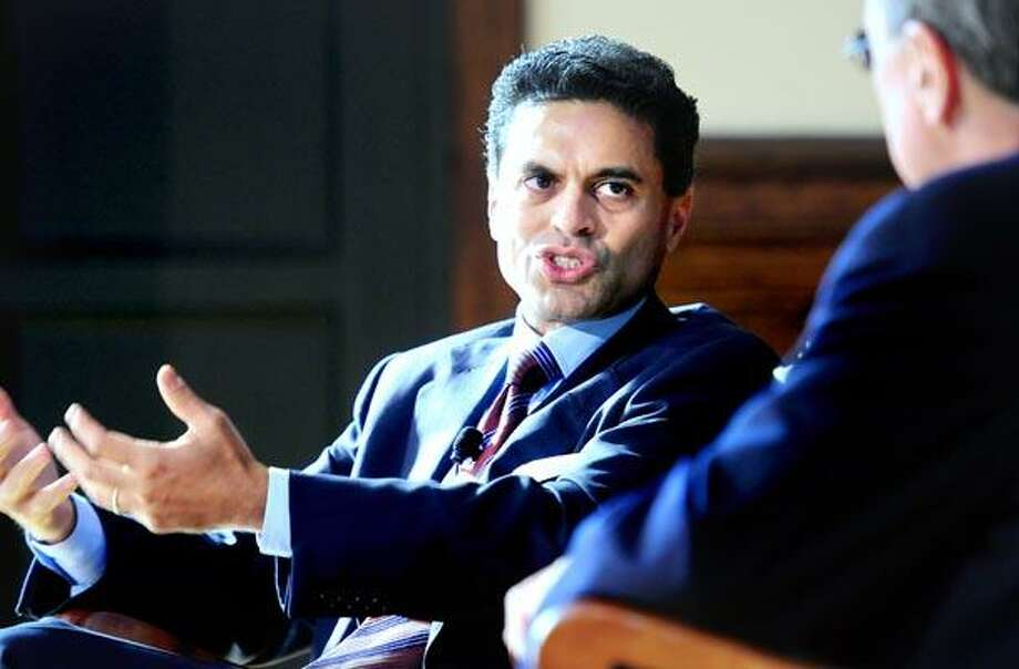 Fareed Zakaria (left), participates in a discussion with Yale President Richard Levin (right) about international affairs at Yale University's Whitney Humanities Center in New Haven on 9/20/2010.Photo by Arnold Gold      AG0385C