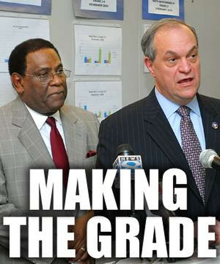 Mayor John DeStefano Jr., with Superintendent of Schools Reginald Mayo looking on, describes the changes in store for the city's school system. At right is Peggy Moore, president of the School Administrators Association union. (Peter Casolino/Register)