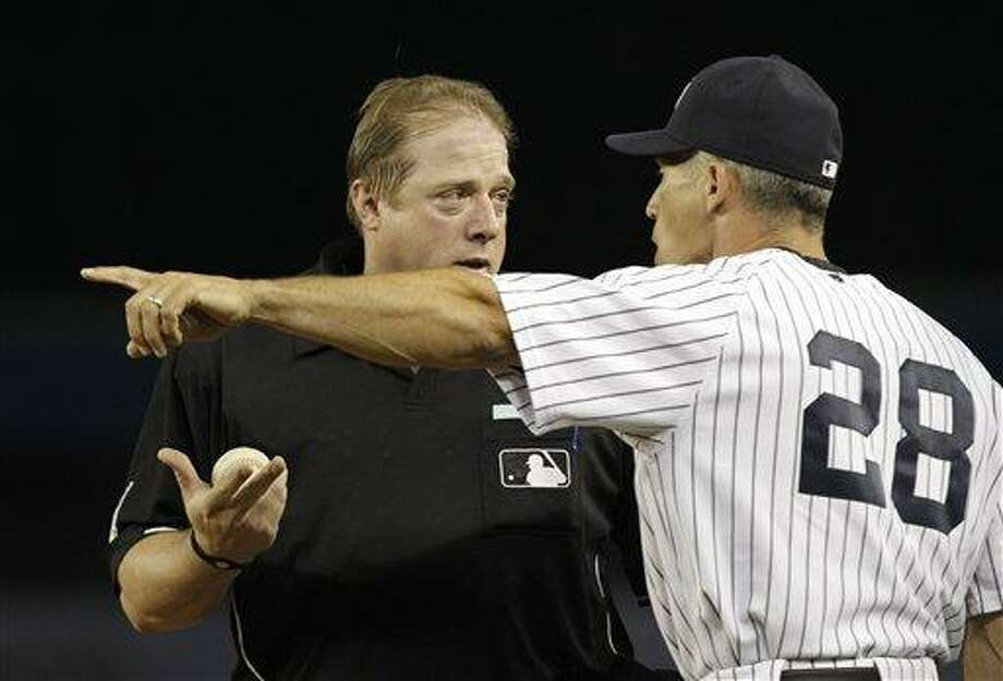New York Yankees manager Joe Girardi (28) argues with home plate umpire Bruce Dreckman after being ejected from the game by first base umpire Paul Emmel during the sixth inning in a baseball game at Yankee Stadium on Tuesday, July 20, 2010, in New York. Girardi had argued with Emmel after Yankees' Mark Teixeira was called out at first. (AP Photo/Kathy Willens) Photo: AP / AP