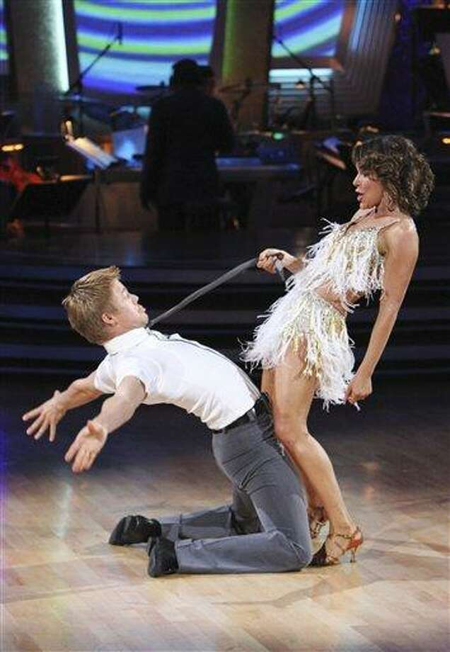 """In this publicity image released by ABC, Jennifer Grey, right, and her partner Derek Hough perform during the celebrity dance competition series, """"Dancing with the Stars,"""" on Monday, Nov. 15, 2010 in Los Angeles. (AP Photo/ABC, Adam Larkey) Photo: AP / © 2010 American Broadcasting Companies, Inc. All rights reserved."""