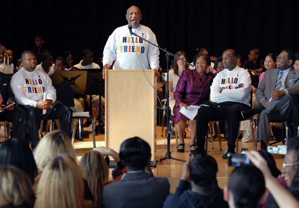 Comedian and educator Bill Cosby visited King/Robinson Interdistrict Magnet IB World School. He was brought to New Haven by SCSU president Stanley Battle second from right. Alsoon stage are State Rep. Gary Holder-Winfield left, principal Iline Tracey 3rd from right, and Reginald Mayo right, superintendent of New Haven schools . Photo by Mara Lavitt/New Haven Register11/23/10