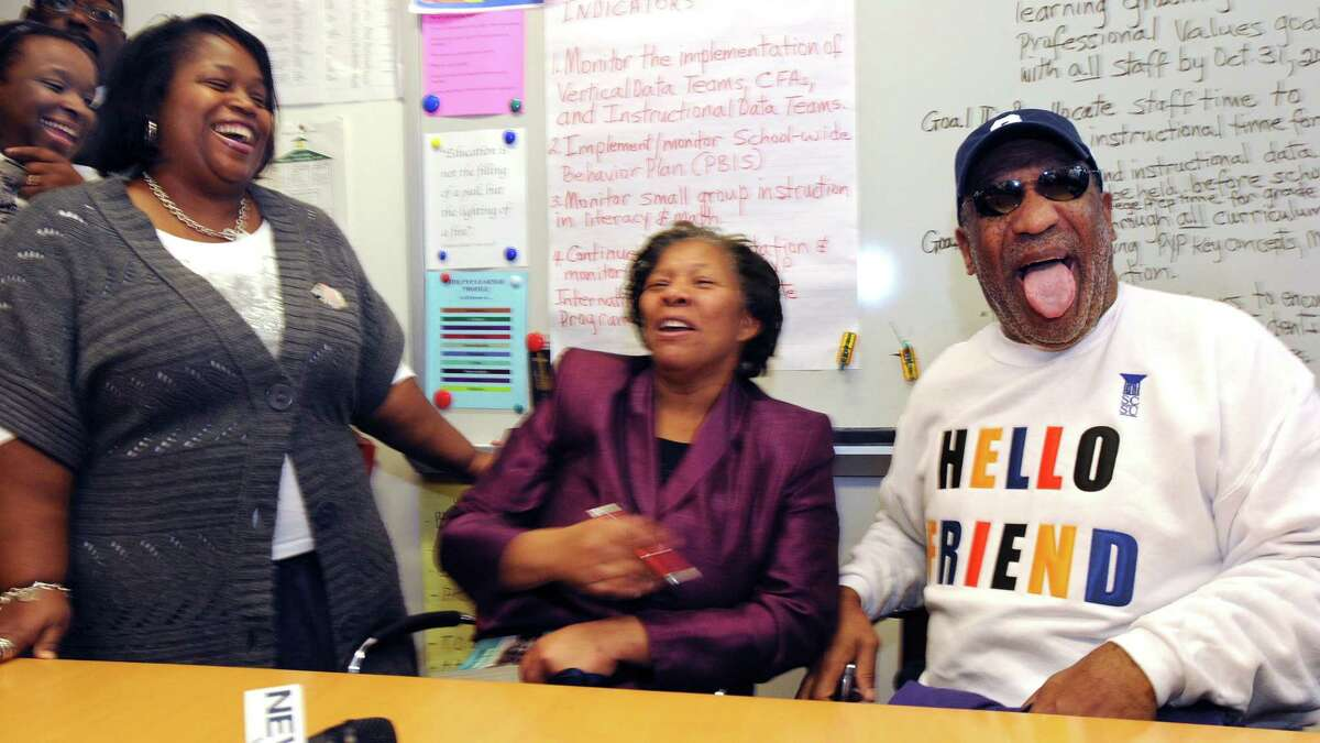 Comedian and educator Bill Cosby visited King/Robinson Interdistrict Magnet IB World School. He was brought to New Haven by SCSU president Stanley Battle. PTO president Alesia Harris left and principal Iline Tracey center crack up after Tracey and Cosby right embraced. Photo by Mara Lavitt/New Haven Register