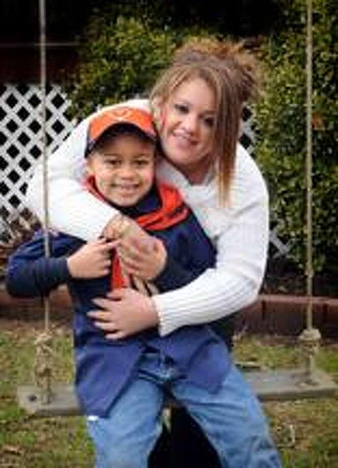 Ivelisse Maldonado of Bridgeport, with her son, Isiah Augustin, 6, is a student at Western Connecticut State Univeristy. (Melanie Stengel/Register)