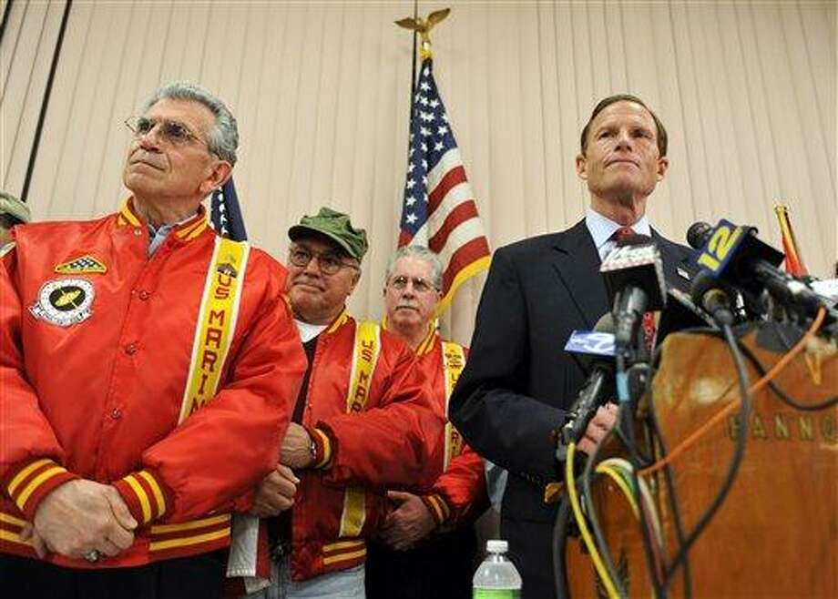 Connecticut Attorney General and Democratic candidate for U.S. Senate Richard Blumenthal, right, stands with veterans as he addresses a report that he has misstated his military service during the Vietnam War at a news conference in West Hartford, Conn., Tuesday, May 18, 2010. (AP Photo/Jessica Hill) Photo: AP / AP2010