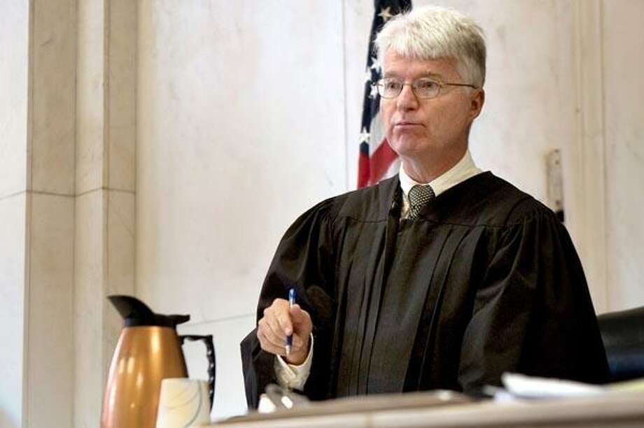 Judge Jon C. Blue was back in the courthouse Monday. (Associated Press file photo) Photo: AP / Pool FR12849AP