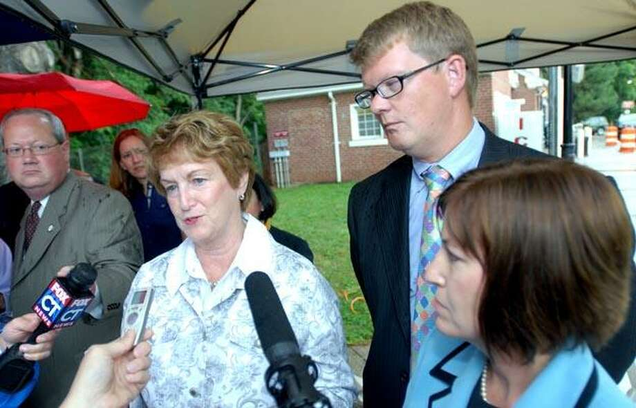 Governor M. Jodi Rell (left) answers questions concerning future plans for the service plaza on southbound Rt. 15 in North Haven on 7/19/2010.  At right is the Jeffrey Parker, commissioner of the DOT. (Arnold Gold/Register)