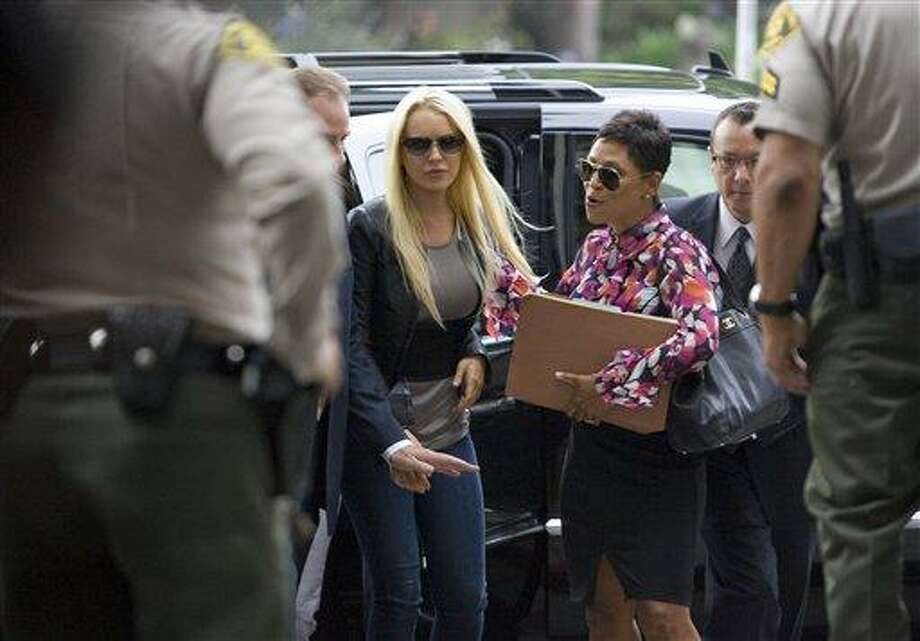 Actress Lindsay Lohan arrives at court in Beverly Hills, Calif., on Tuesday, July 20, 2010, to begin serving a 90 day jail sentence for violating the terms of her probation. (AP Photo/Jason Redmond) Photo: AP / FR74394 AP