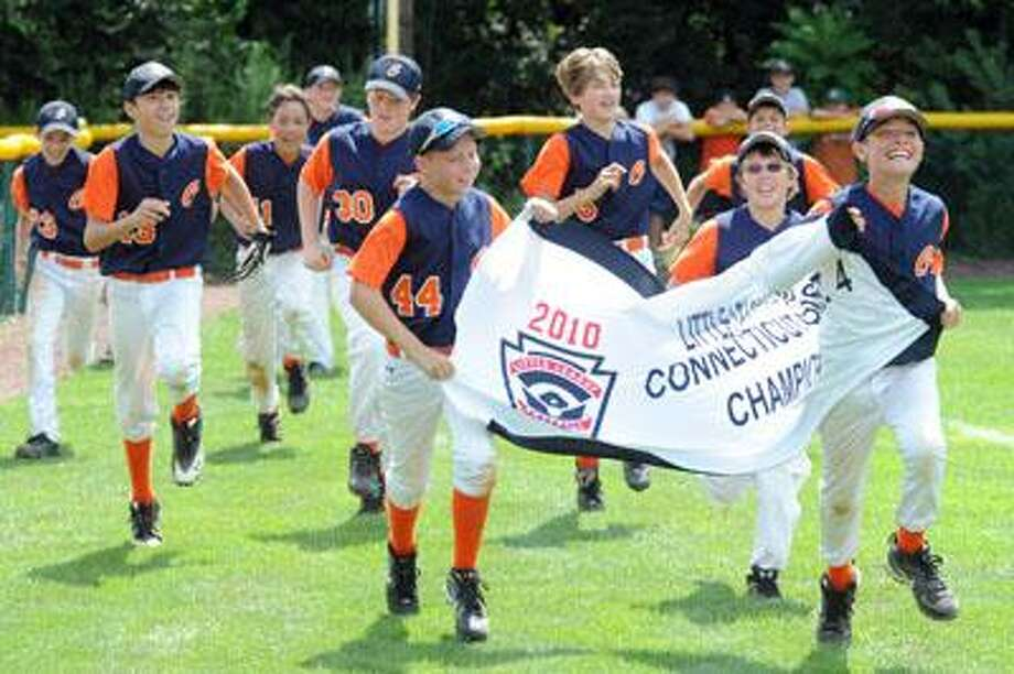 The Orange Little League team celebrates its 5-0 win over Branford with a victory lap Tuesday, after the game was delayed for 15 hours by a thunderstorm Monday evening. (VM Williams/Register)
