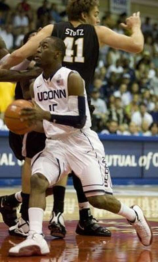 Connecticut guard Kemba Walker (15) drives to the basket while playing against Wichita State in the first half during the Maui Invitational in Lahaina,Hawaii Monday, Nov. 22, 2010. (AP Photo/Eugene Tanner) Photo: AP / Associated Press