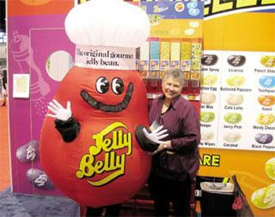 Author Katharine Weber, here with Jelly Belly, did some of her research at candy conventions, such as this one in Chicago. (Contributed)