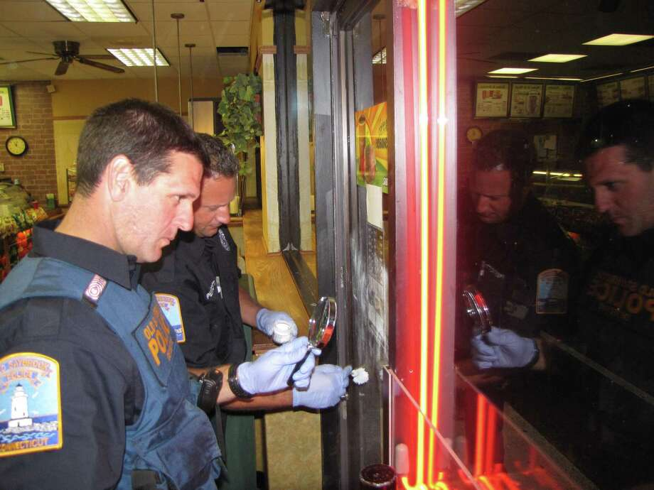 Old Sabrook police detectives work at the site of the Subway robbery. (Old Saybrook Police Department photo)