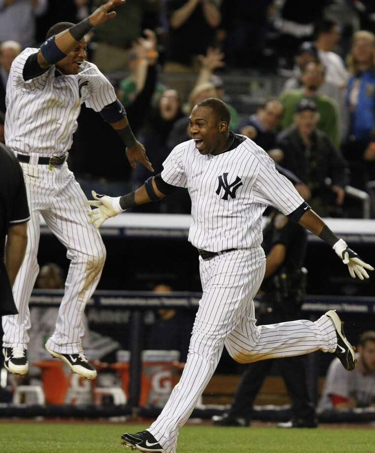 New York Yankees' Robinson Cano, left, leaps after Marcus Thames, right, hit a walkoff home run in the Yankees' 11-9 defeat of the Boston Red Sox in a baseball game at Yankee Stadium in New York, Monday, May 17, 2010. (AP Photo/Kathy Willens) Photo: ASSOCIATED PRESS / AP2010