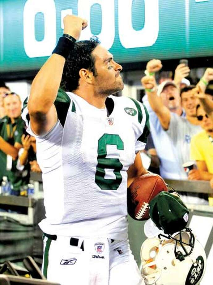 Jets quarterback Mark Sanchez outplayed Patriots QB Tom Brady during New York's 28-14 win Sunday in East Rutherford, N.J. (Associated Press)