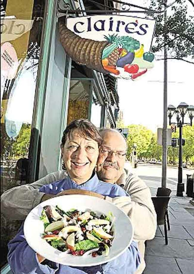 Claire and Frank Criscuolo, husband and wife owners of Claire's Corner Copia restaurant, show one of their dishes. (Peter Hvizdak/Register)