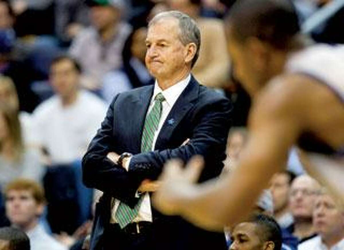 UConn coach Jim Calhoun grimaces as he watches his Huskies blow a 19-point lead in a loss to Georgetown, Saturday. (Associated Press)