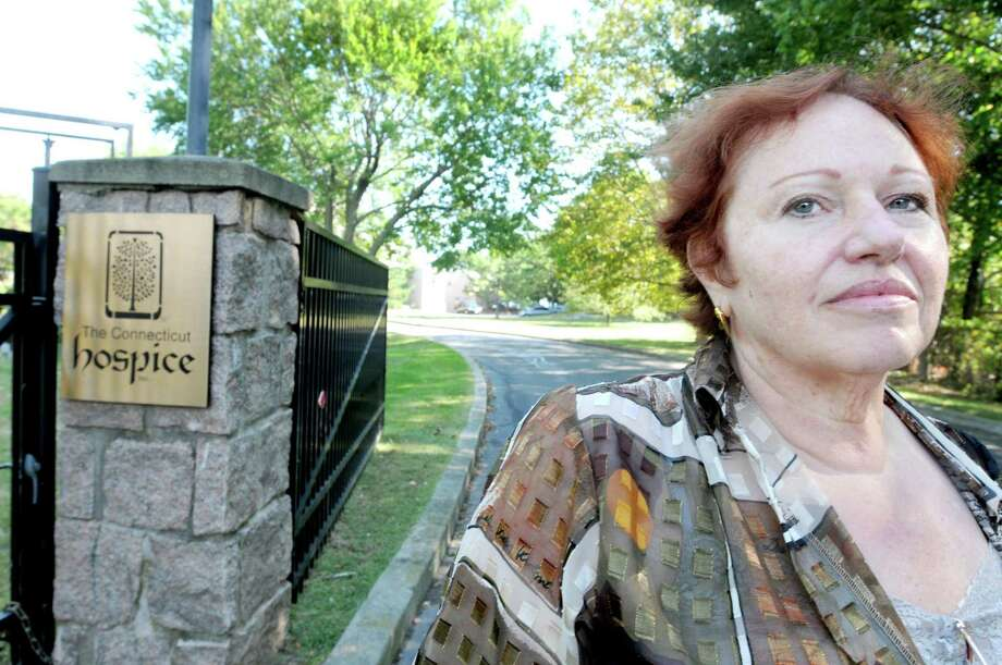 Susane Grasso of New Haven, a former Director of Complementary and Alternative Medicine for Connecticut Hospice in Branford stands in front of the hospice Sunday after not being denied access to the grounds to attend a memorial service.