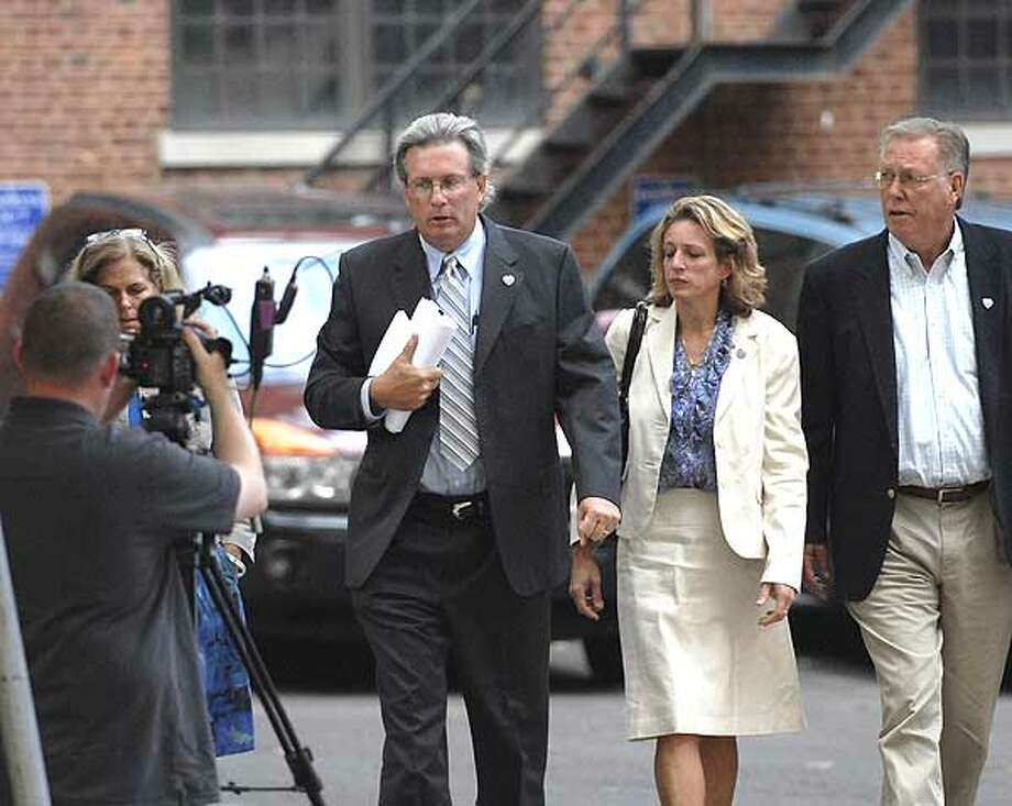 Dr. William Petit Jr makes his way into court with family last week for the Stephen Hayes Trial. The family's frustration grows as the trial is now delayed until Wednesday after the judge fell ill. (Photo by Peter Casolino)