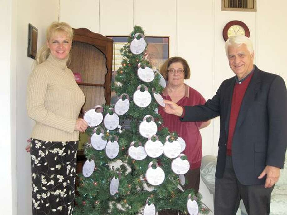 Home Instead photo, Lending a hand with Be a Santa to a Senior program on the Shoreline are Robin Vedder, left, Hattie Sussman and Rick Cortellessa of Home Instead Senior Care in Guilford.