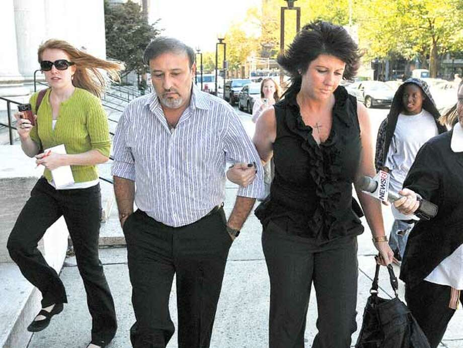 Shelton developer James Botti and an unidentified woman leave U.S. District Court in New Haven Friday, after Botti was sentenced to six years in prison. (Peter Casolino/Register)