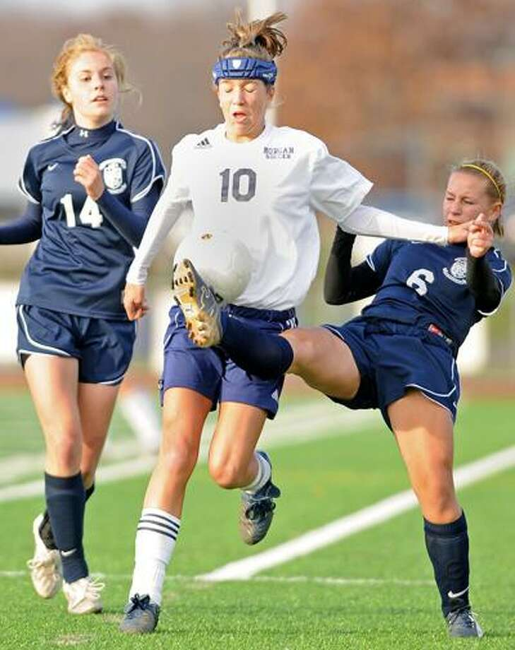 West Haven--Morgan's Emily Perzanoski, center, fights for the ball between Immaculate's Katrina Clark and Kayla Brady. Photo by Brad Horrigan/New Haven Register-11.20.10.BH0717-101120.