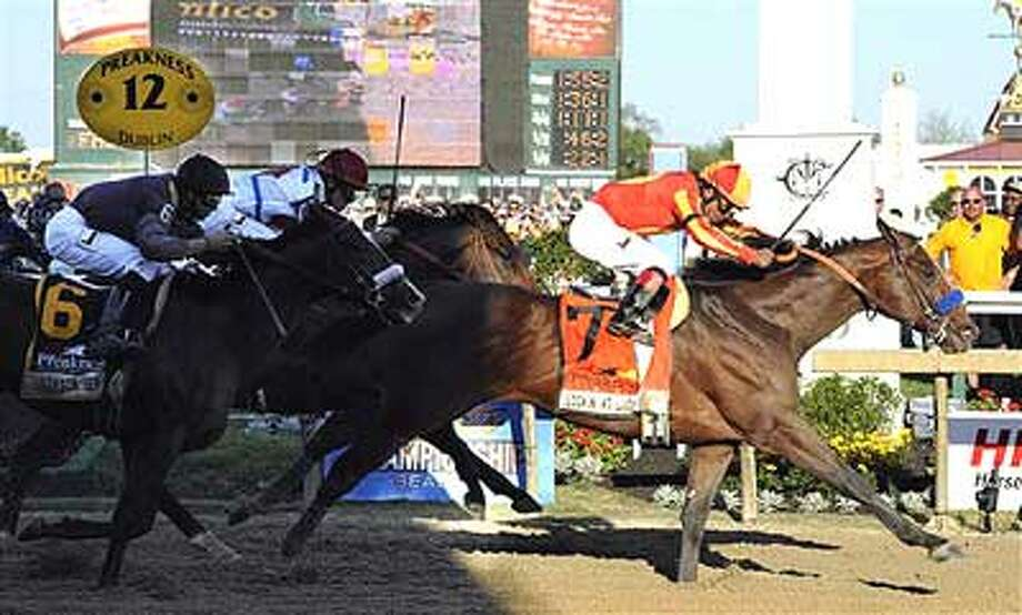 Lookin At Lucky (7), with Martin Garcia aboard, moves over the finish line to win the 135th Preakness horse race at Pimlico Race Course, Saturday, May 15, 2010, in Baltimore. (AP Photo/Mike Stewart)