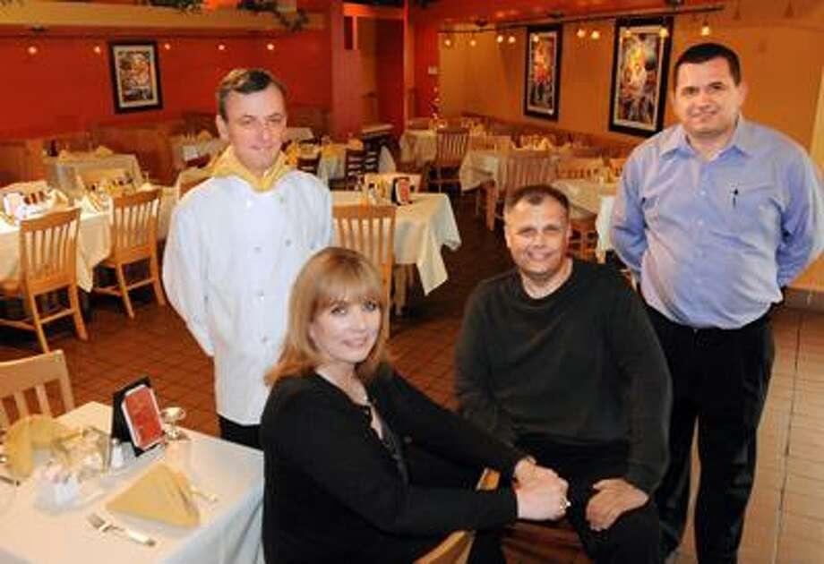 Left to right: Chef Adamo Basuljevic, Stephanie Lucarelli. Rick Lucarelli, and Eddie Lulani, of Lucarelli's Restaurant in Derby. (Melanie Stengel/Register)