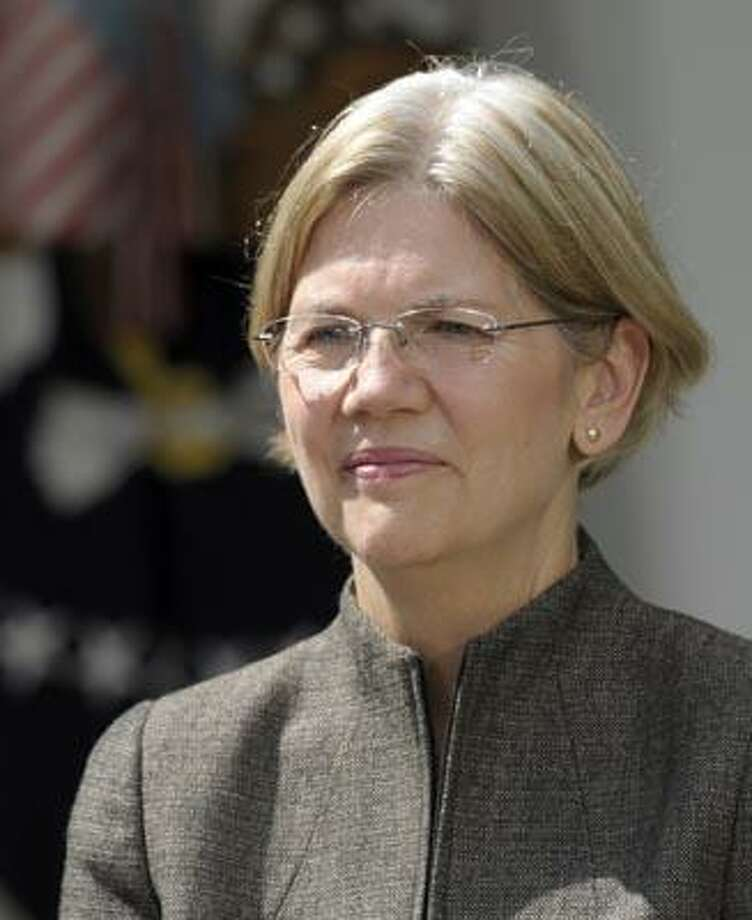 Elizabeth Warren is seen in the Rose Garden of the White House in Washington, Friday, Sept. 17, 2010, where President Barack Obama announces that she will head the Consumer Financial Protection Bureau. (AP Photo/Susan Walsh) Photo: AP / AP