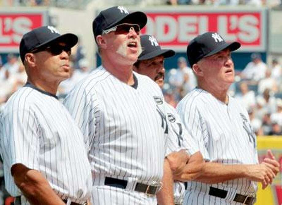 """Retired New York Yankee's, left to right, Reggie Jackson, Rich """"Goose"""" Gossage, Ron Guidry, and Graig Nettles participate in Old Timers' Day ceremonies at Yankee Stadium on Saturday, July 17, 2010 in New York. (AP Photo/Frank Franklin)"""